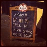 Pub sign saying No wi-fi. Talk to each other